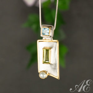 Sterling silver and 22k vermeil pendant with peridot and blue topaz