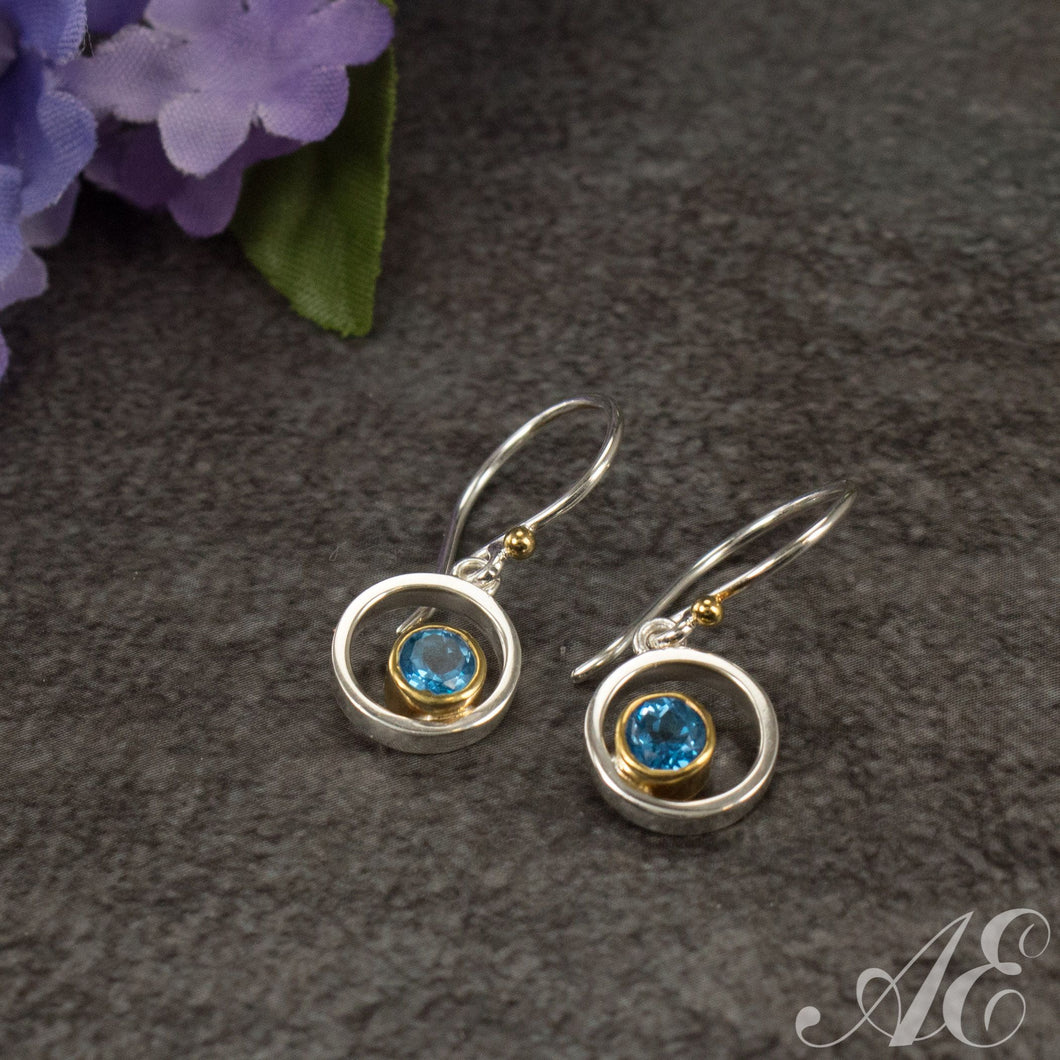 Sterling silver earrings with 22k gold overlay and blue topaz
