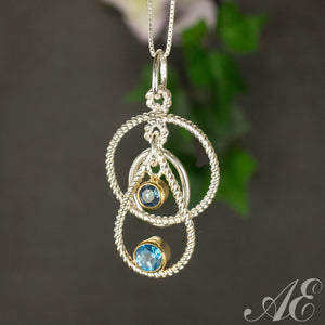 Sterling silver and 22K gold overlay pendant with blue topaz