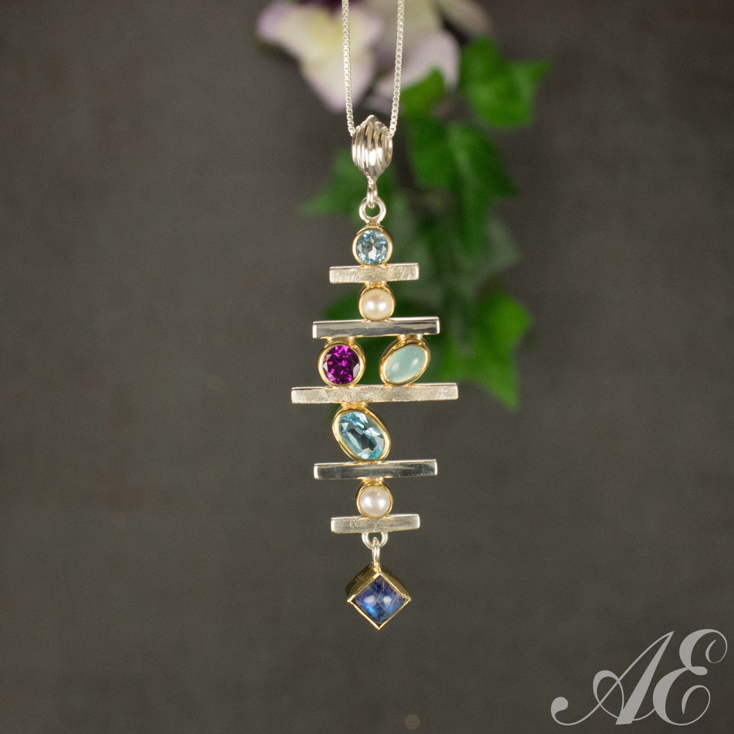 Sterling silver pendant with amethyst, blue topaz, garnet, pearl and peridot