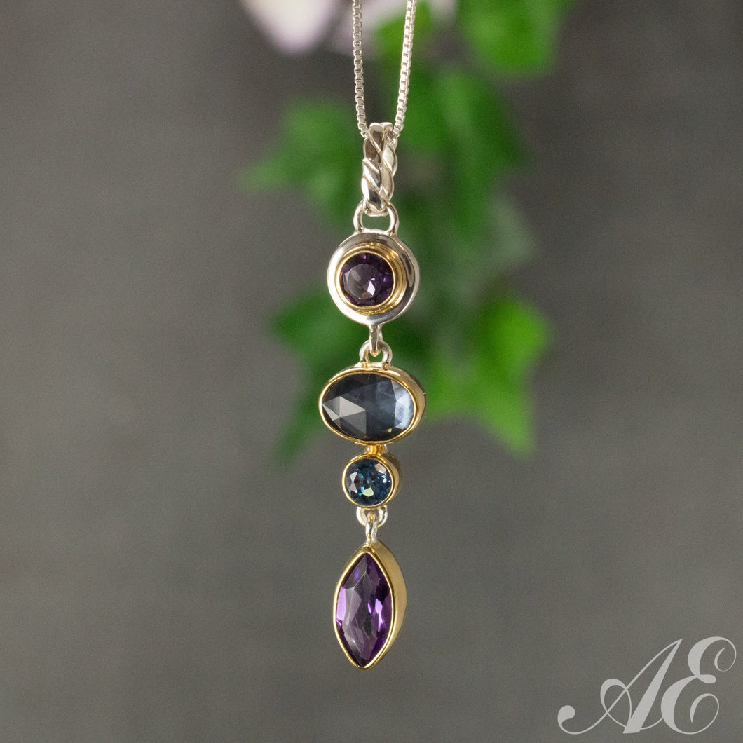 Sterling silver and 22k vermeil pendant with blue topaz, amethyst and moonstone