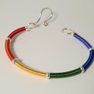 "Bracelet - ""Don't Hide Your Pride"" Colorful rainbow wire wrapped Sterling Silver bracelet."