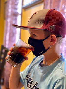 Kids can drink in a face mask without taking it off.