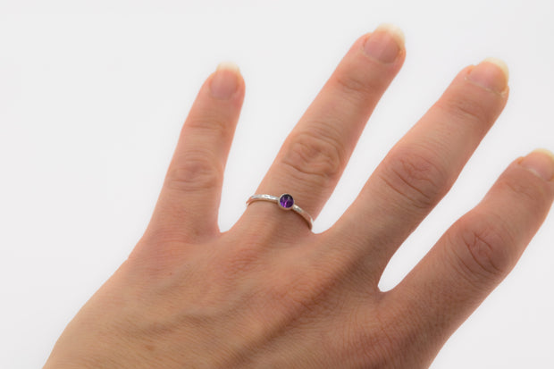 textured sterling silver stackable amethyst ring on model