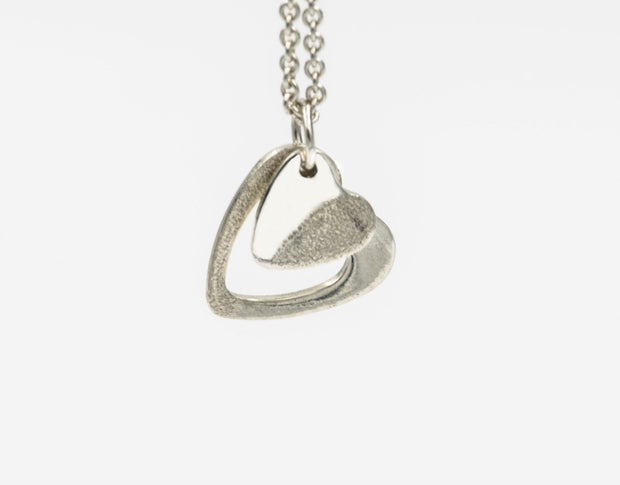 Two Hearts Pendant Necklace in Sterling Silver