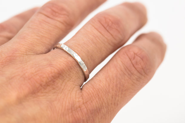 Textured-sterling-silver-ring-on-model