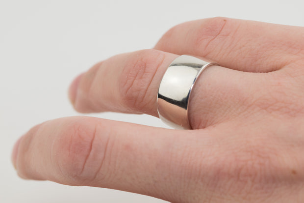 Wide sterling silver comfort fit ring on model