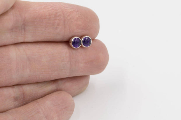Amethyst post earrings sterling silver in hand
