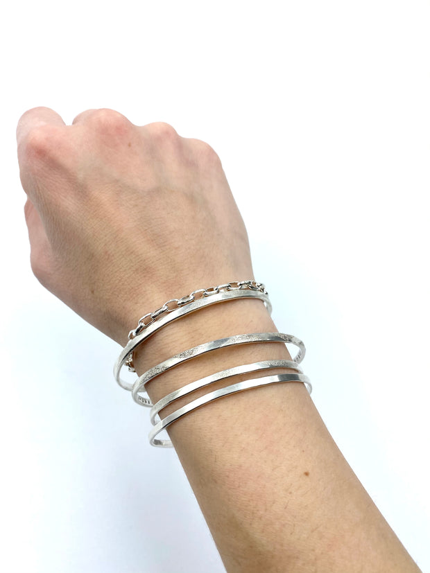 paperclip_sterling_silver_chain_link_bracelet_on_model_stacked