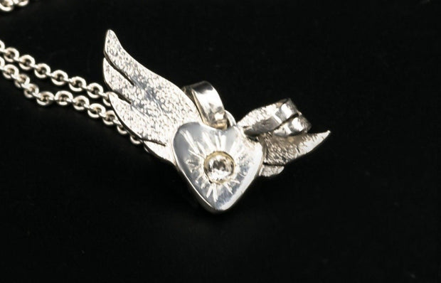 Angel Wing Pendant Necklace in Sterling Silver with White Topaz Stone