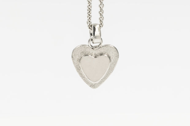 Tiny Heart Pendant Necklace in Sterling Silver