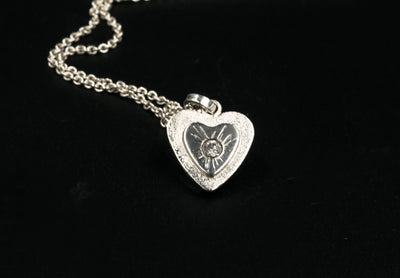 sterling-silver-hearts-pendant-w-white-topaz-gemstone