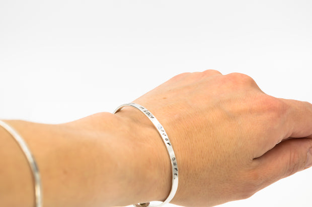 sterling_silver_hand_stamped_bracelet_on_model