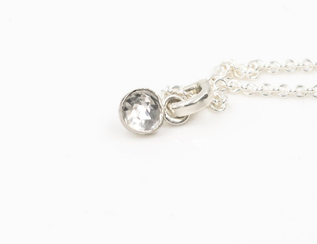 Tiny White Topaz Pendant in Sterling Silver