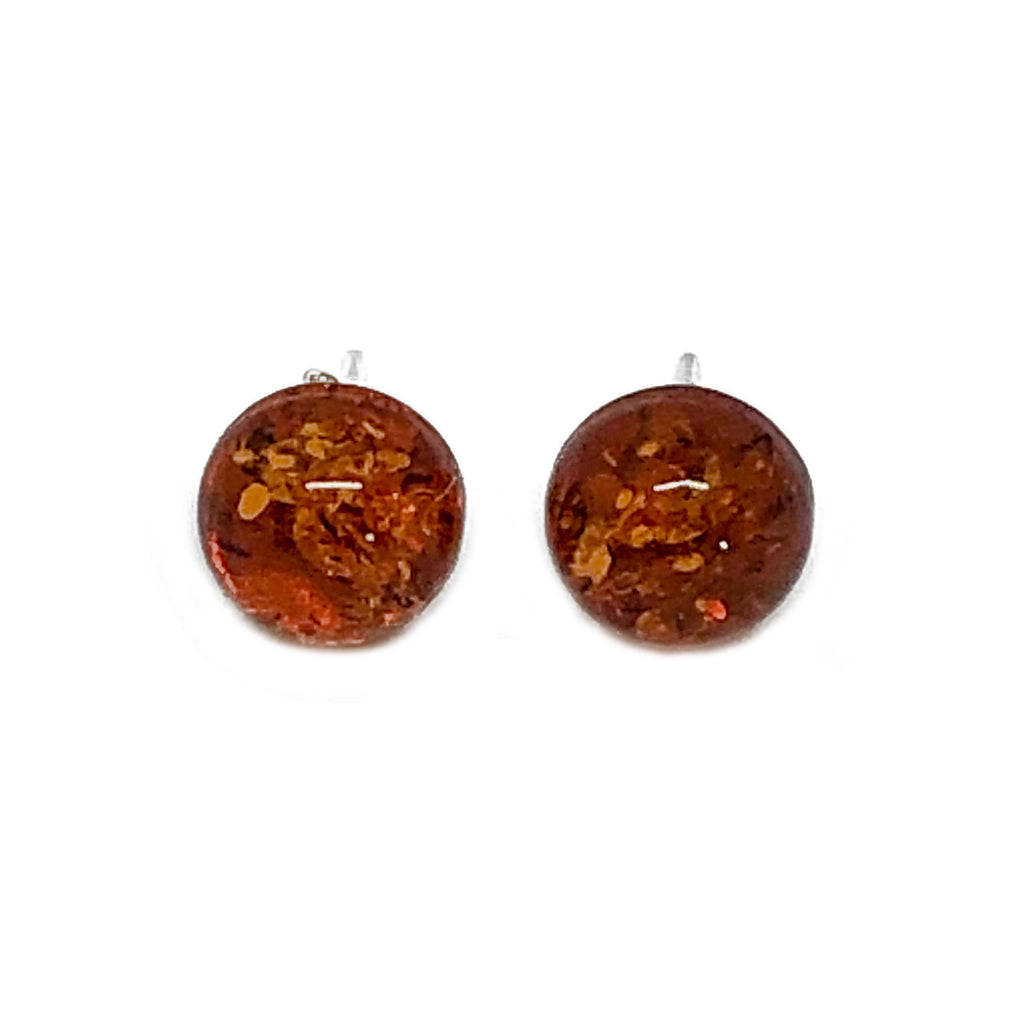 The Amber Centre. These simple amber balls are mounted on Sterling silver posts. A beautiful understated way to wear your amber.  Each amber ball is approximately 10mm.