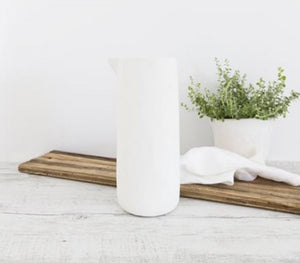 Flax jug in snow. Beautiful organic shaped jug with no handle comes in 2 sizes.  Choose the best size for your needs or have them all grouped together on show and ready for use as needed.