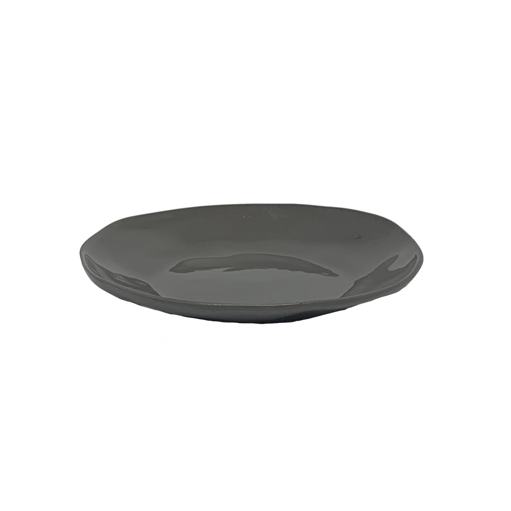 Flax side plate in charcoal. A gorgeous little side plate available in 2 sizes, serve a few little cookies or chocolates or some cheese. This organic shape fits perfectly in your modern home.