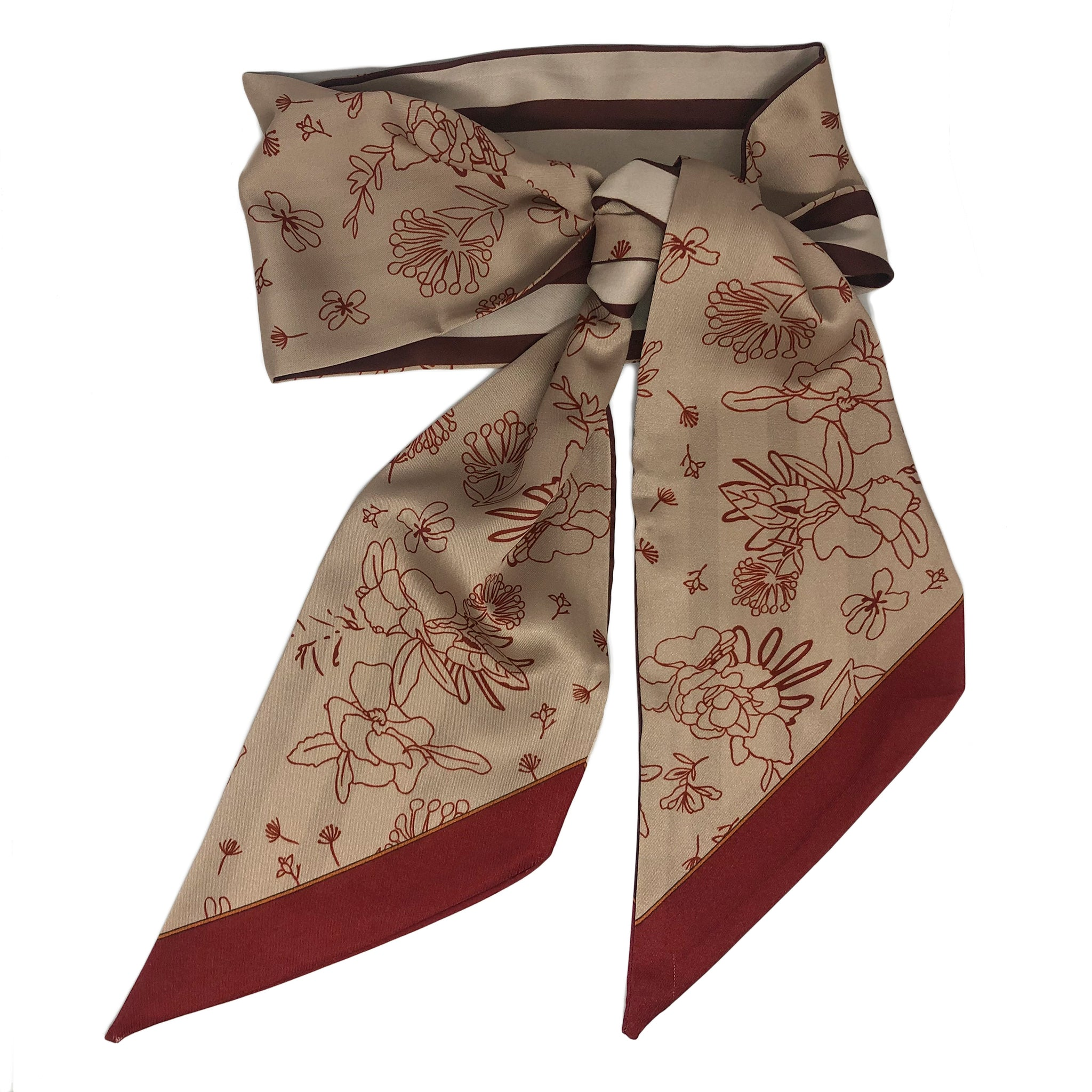 Herricks Scarf. This elegant neck scarf is just perfect to add a touch of difference to your outfit.  Lightweight and silky smooth it has a mushroom background with red floral design on one side and a contrasting stripe on the other.   Measures L 134 cm x W 12.5cm.