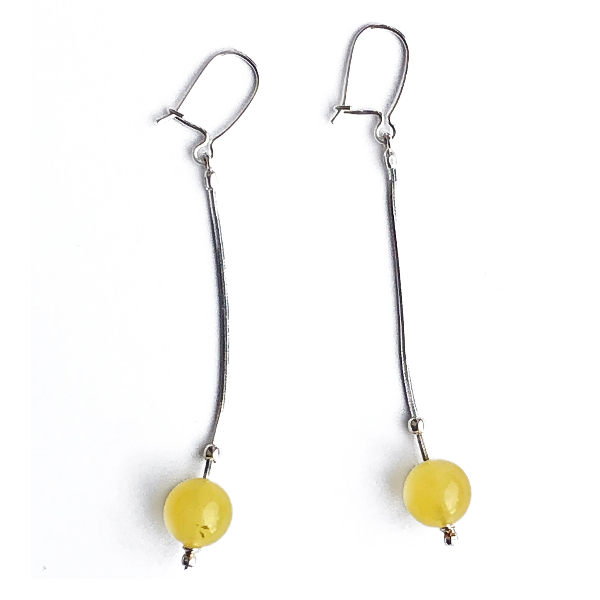 The Amber Centre. Unusual Lemon Amber ball drop earrings are hung on simple snake chain drop and hook and catch for pierced ears.  Length 70mm Ball 9mm.