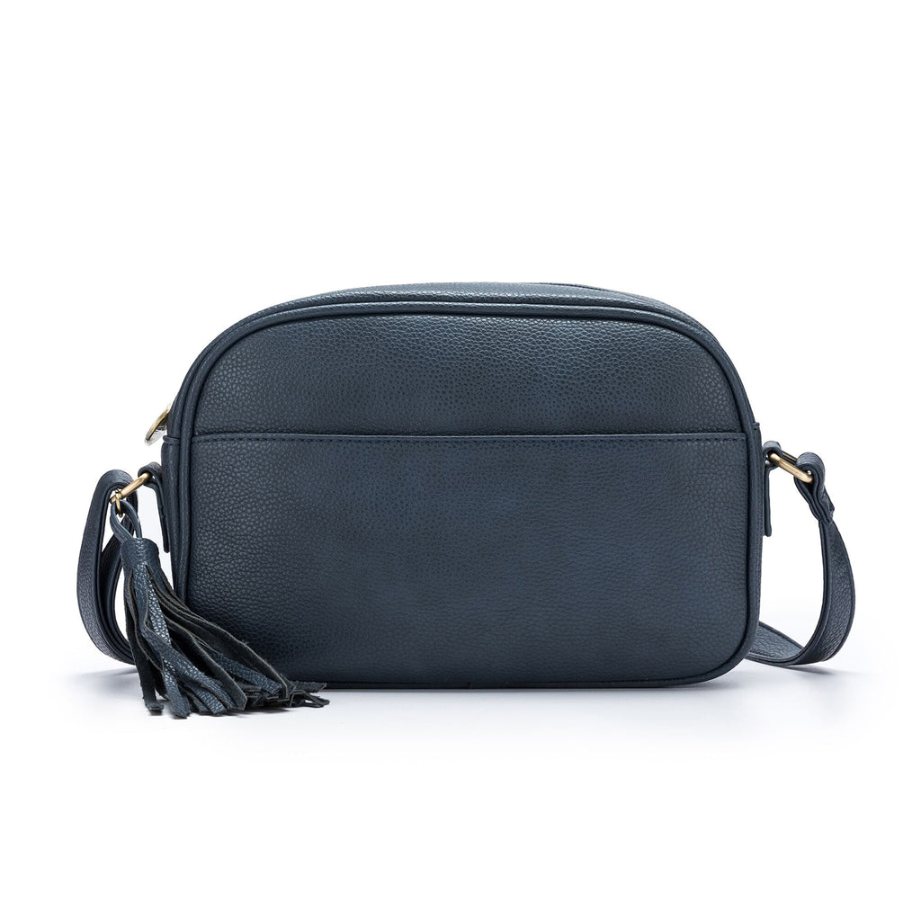 Vegan leather cross body bag by Black Caviar Designs features zip closure with pockets front and back (back is zipped). Lined with black and white cotton. Adjustable handle.  Made from premium polyurethane with brushed gold hardware.  Measures H 17cm x W 24.5cm x D 7cm.