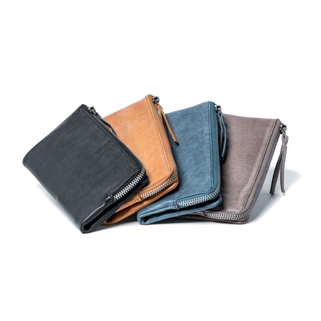 Oran Leather's soft smooth ladies leather wallet features one window and 9 card slots, 4 extra sections and a deep section for notes.  Press stud closure with zip around notes section.  H 18 cm x L 9.5 cm x W 2.5 cm.
