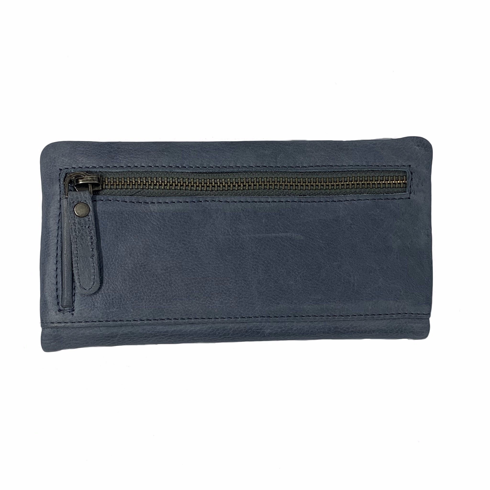 The Martina wallet is made of beautiful soft leather and features a double magnetic closure. There are 12 card holders, one notes compartment and one coin compartment with zip closure. It has a blue, cotton, woven lining and an additional external back zip.   H 10 cm x L 18.5 cm x W 2 cm.