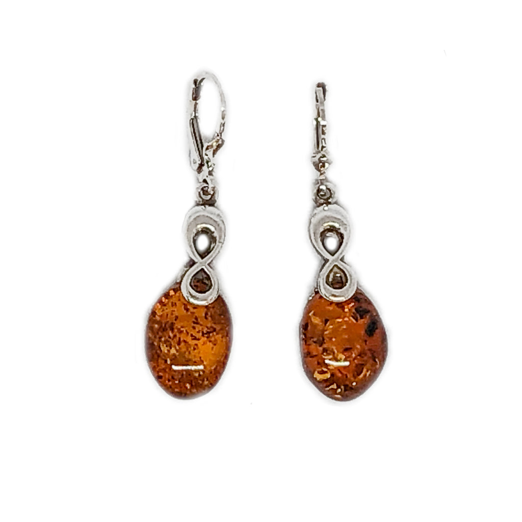 The Amber Centre. This beautiful pair of cognac amber earrings are supported at the back on a plain Sterling silver surround and suspended on very secure hooks that fasten behind the ear. The Sterling silver bail has an interesting infinity style design which supports the unadorned amber. The amber itself has some lovely inclusions and a clarity that catch the light beautifully.  Each piece of amber measures approximately 16mm x 12mm. Length of earring including hook 45mm.