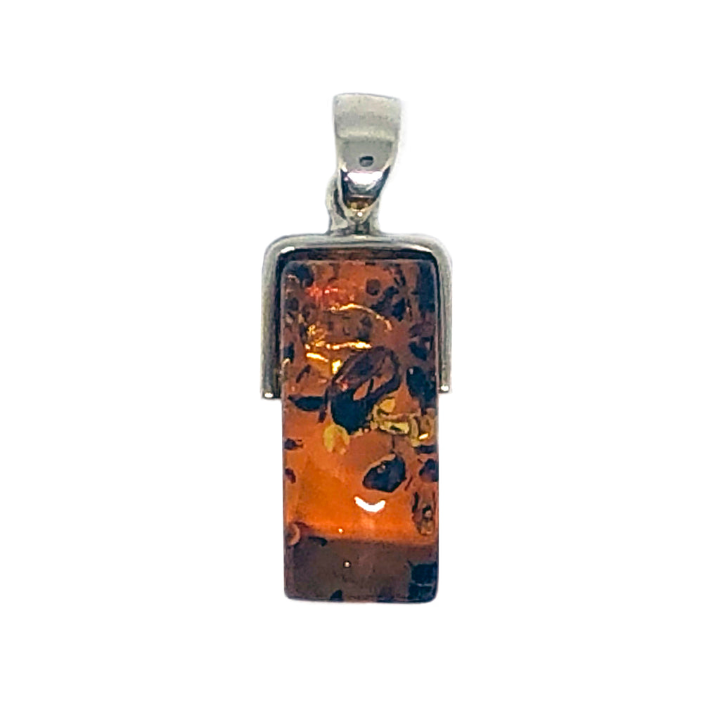 The Amber Centre. Gorgeous rectangular piece of cognac coloured amber with some lovely inclusions.  This piece is set in a stunning plain silver bail around the top only leaving the amber to be the main focus of this beautiful pendant.