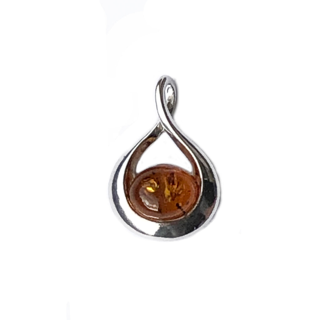 The Amber Centre. This sweet little piece of golden amber nestles in a Sterling silver hammock.  There are some nice inclusions in the amber and the understated elegance of this pendant will make it your go to piece for everyday wear.  Amber measures 8mm long and 12 mm wide. Full pendant measures 25mm long and 17mm wide.