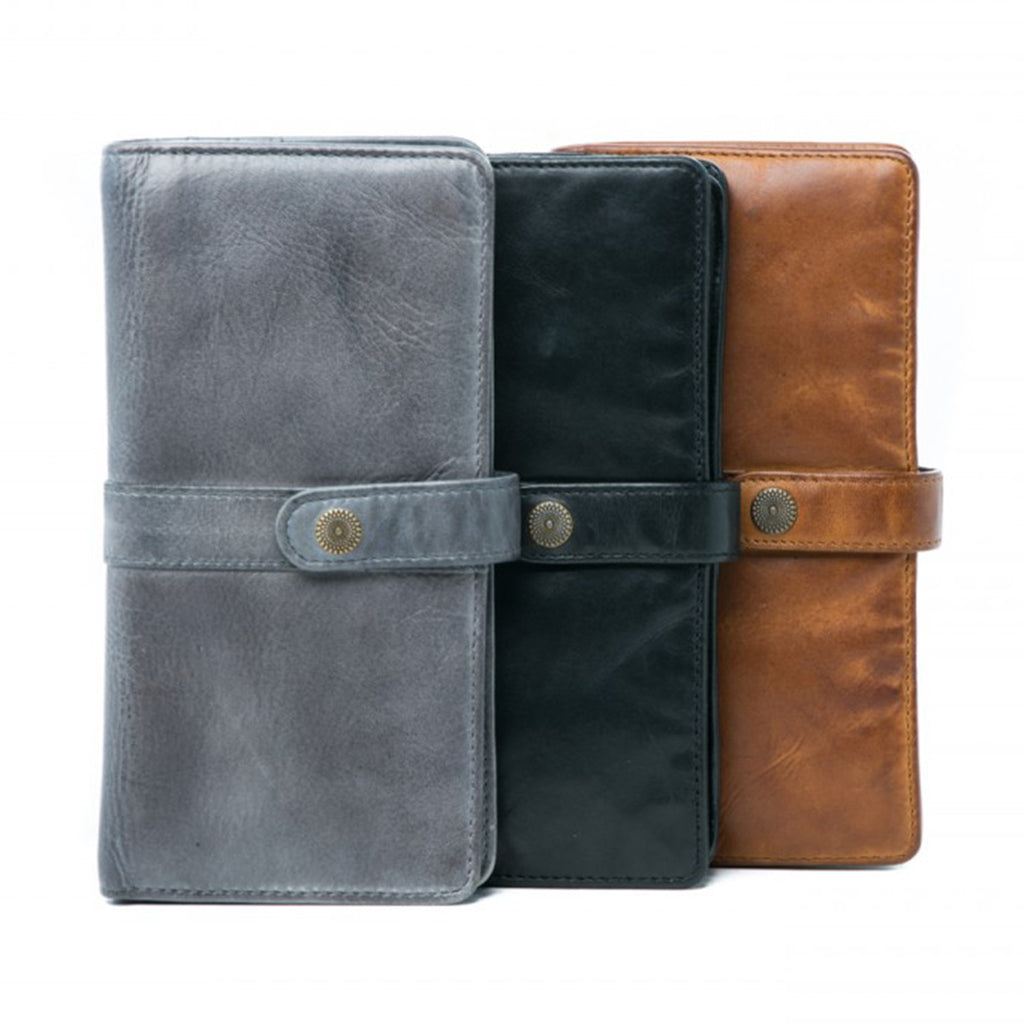 Oran Leather's Soft Leather Robyn wallet with press stud fastener is from the Rugged Hide range.  Features 12 card slots, 3 compartments suitable for notes and receipts and an internal zipped compartment for coins.