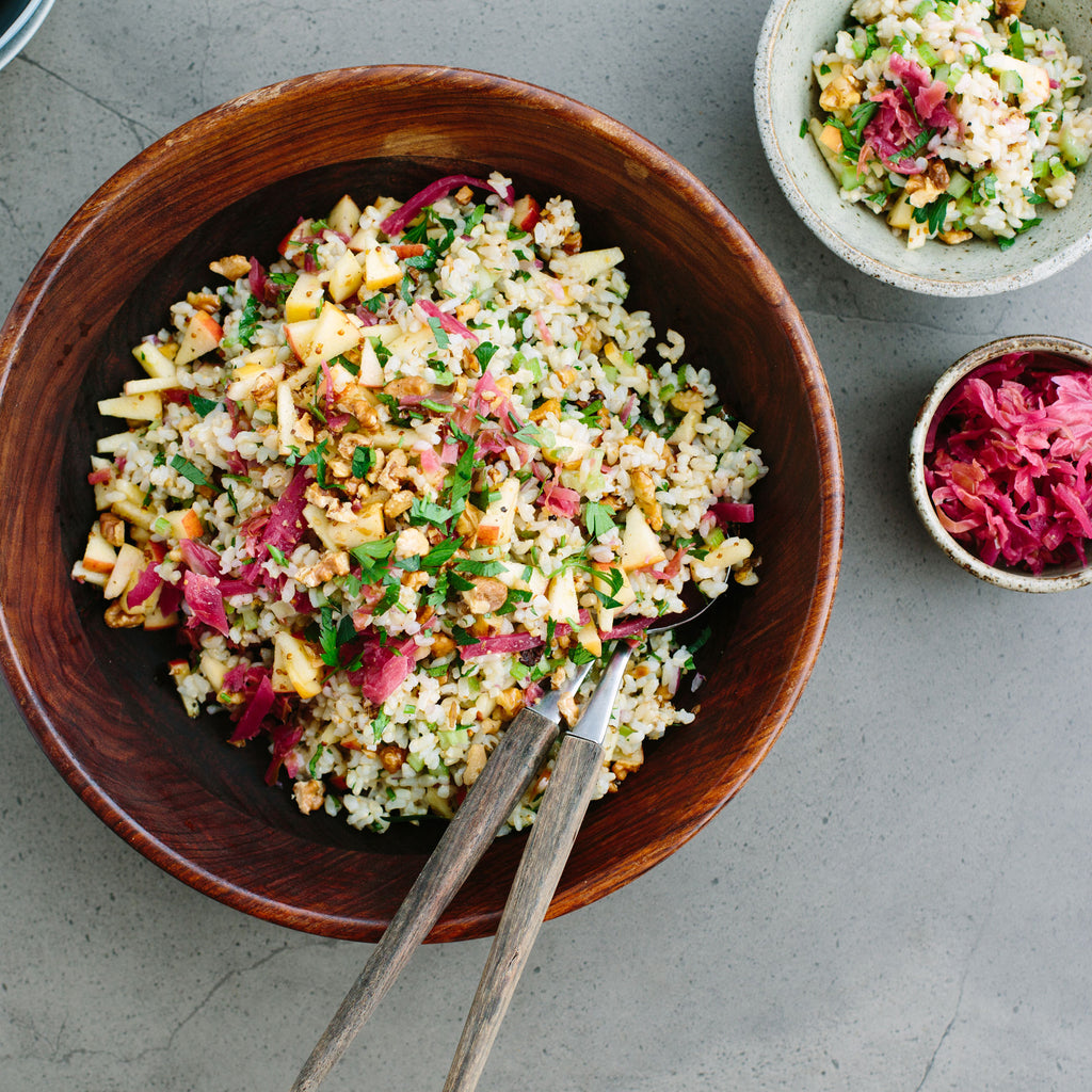 Brown rice salad with apple, celery, kraut + mustard seed dressing