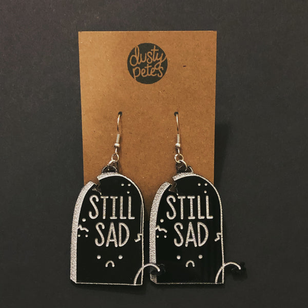 still sad tombstone earrings