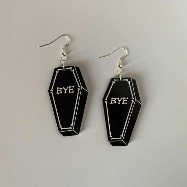 """bye"" coffin earrings"