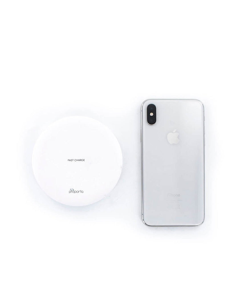 Size comparison image of the Proporta Universal Smartphone wireless charger in White