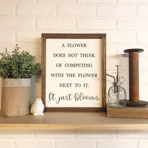 A Flower Does Not Think Of Competing Framed Sign