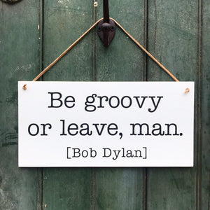 Be Groovy Or Leave, Man Hanging Sign