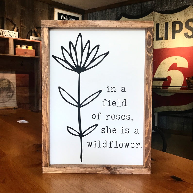 In A Field Of Roses She Is A Wildflower Framed Sign