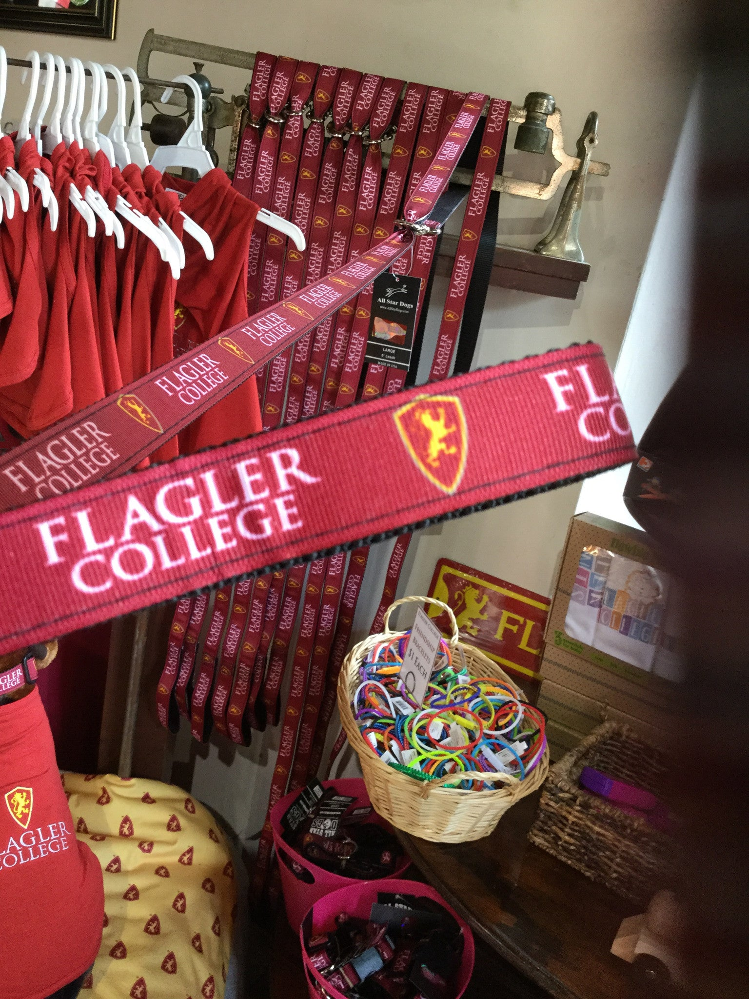 red dog leash with Flagler college printed in white and shield printed in red and yellow