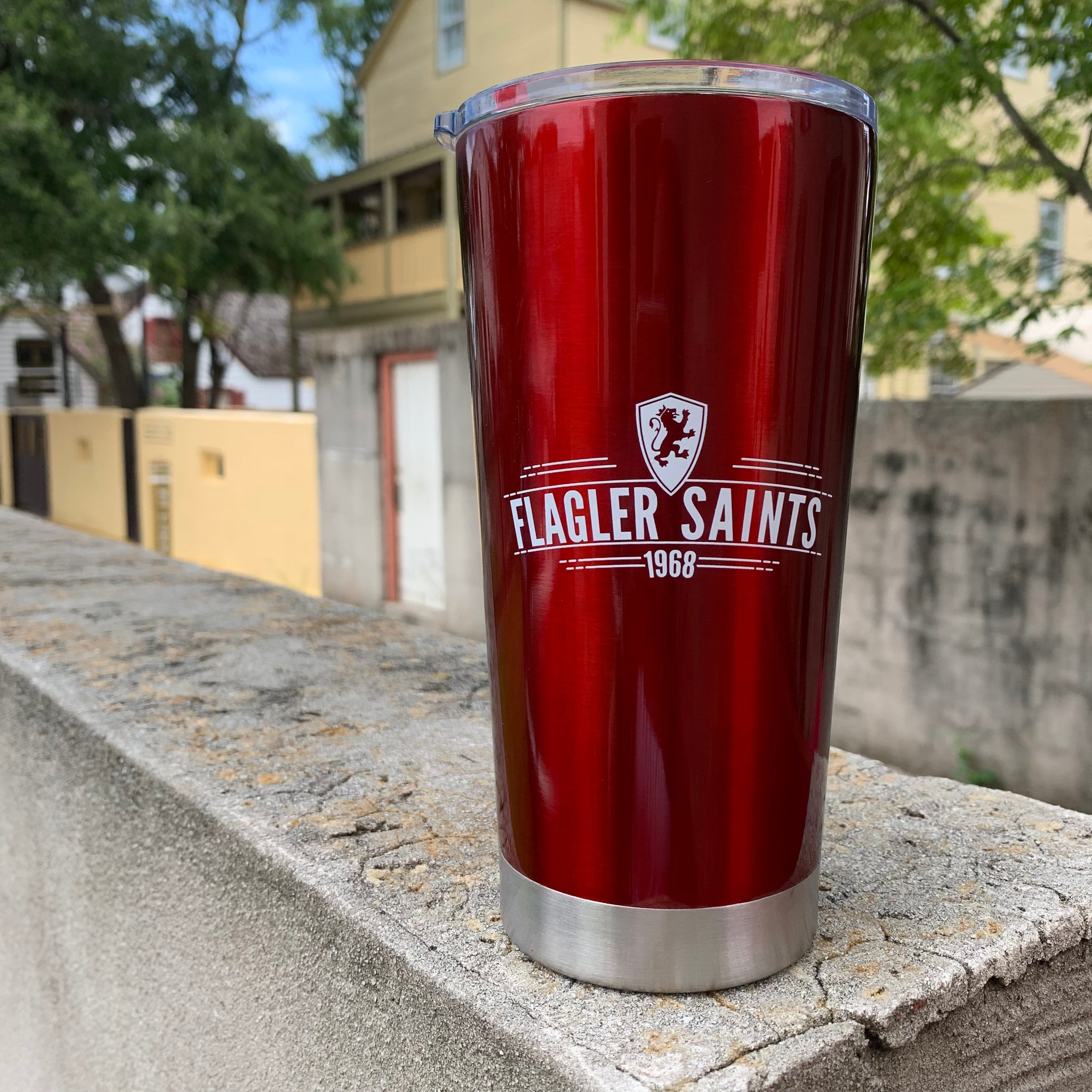 20.9 oz red travel tumbler with shield, Flagler saints and 1968 printed in white