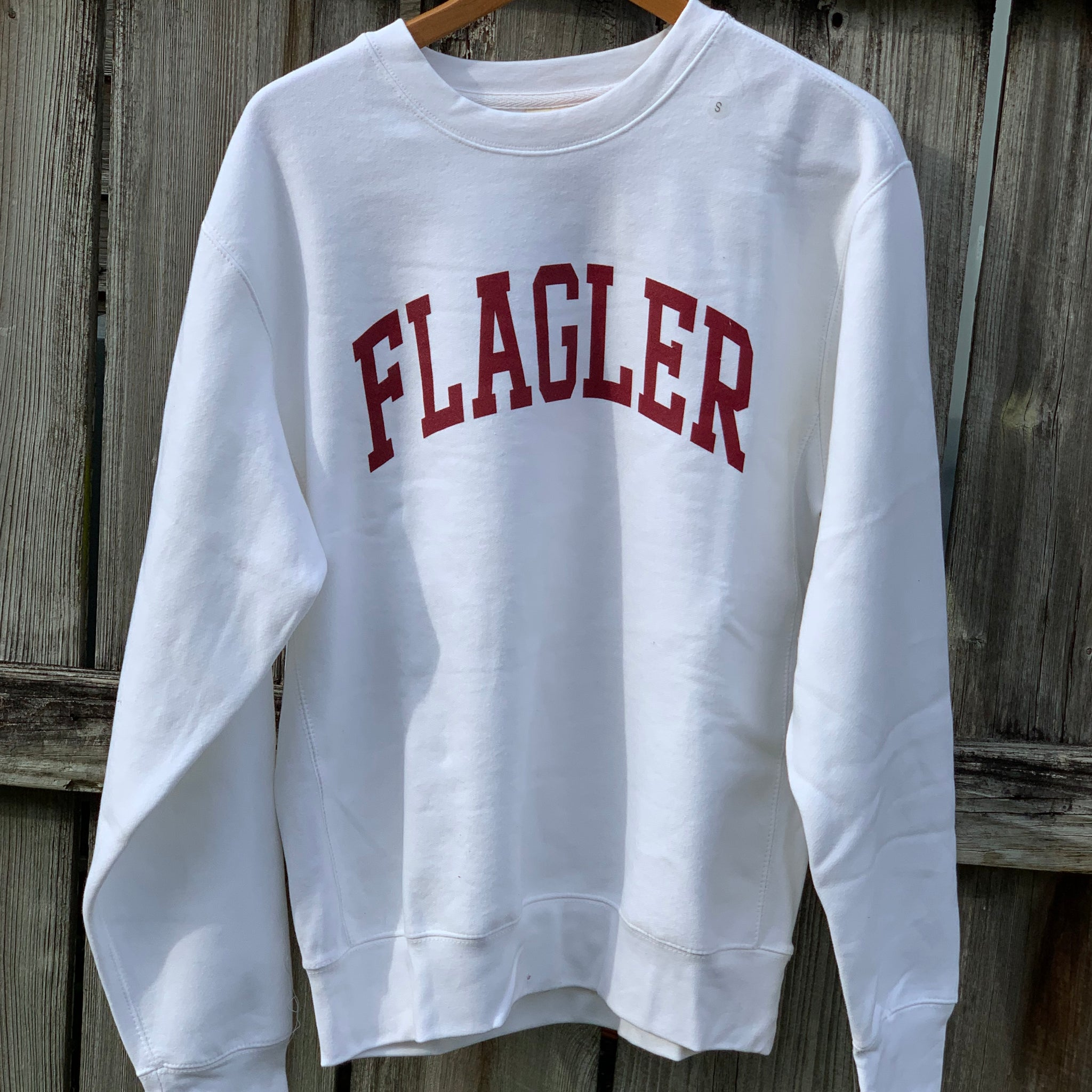 white crew with Flagler printed in red across the chest
