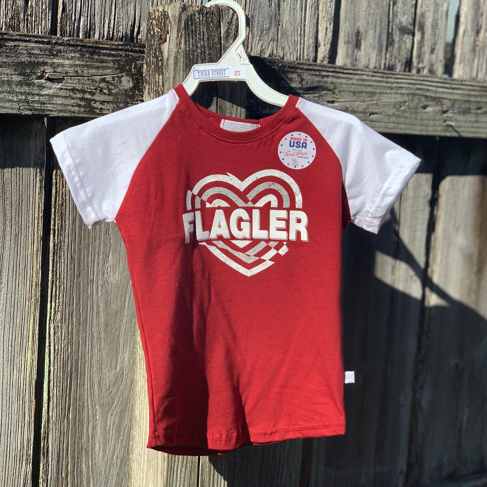 red girls t-shirt with Flagler printed in white in the middle of a heart