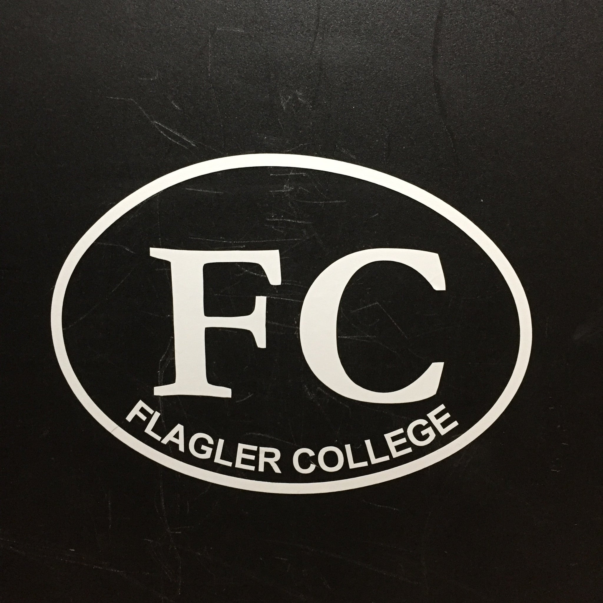 White oval decal with FC in the middle and Flagler College printed at the bottom