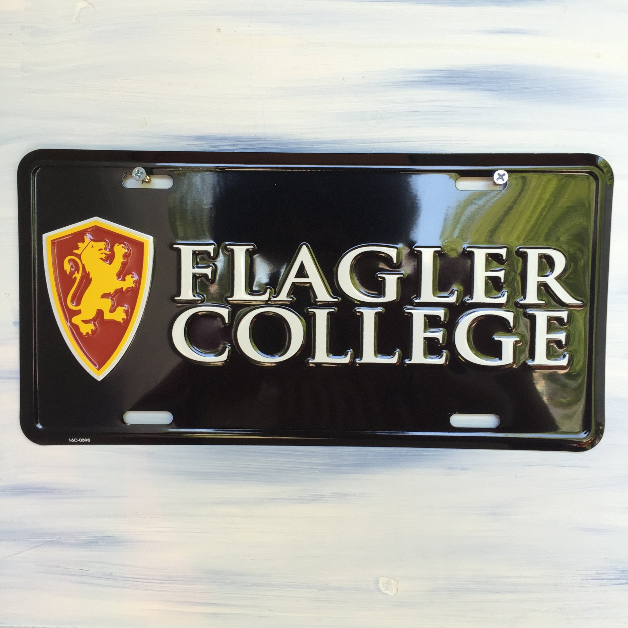 black front license plate with gold and red lion shield and Flagler College in white text