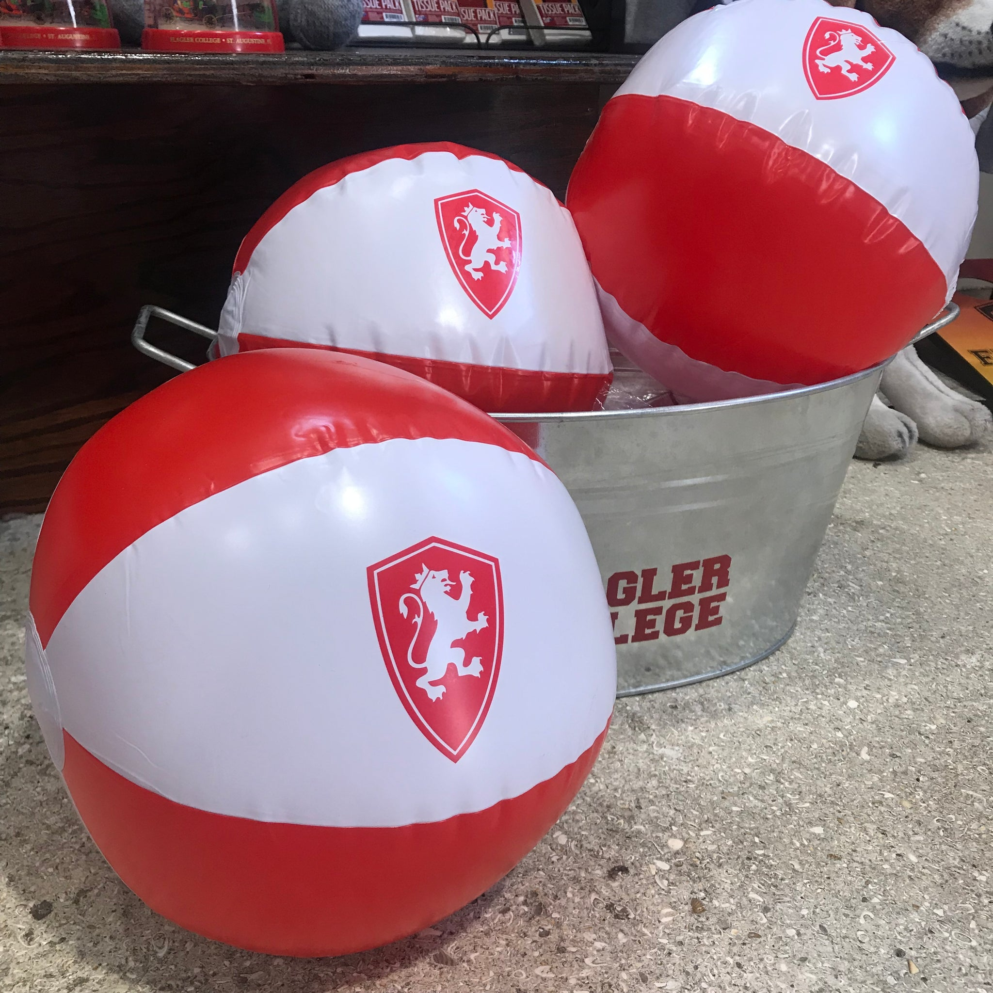 red and white beach ball with red lion shield