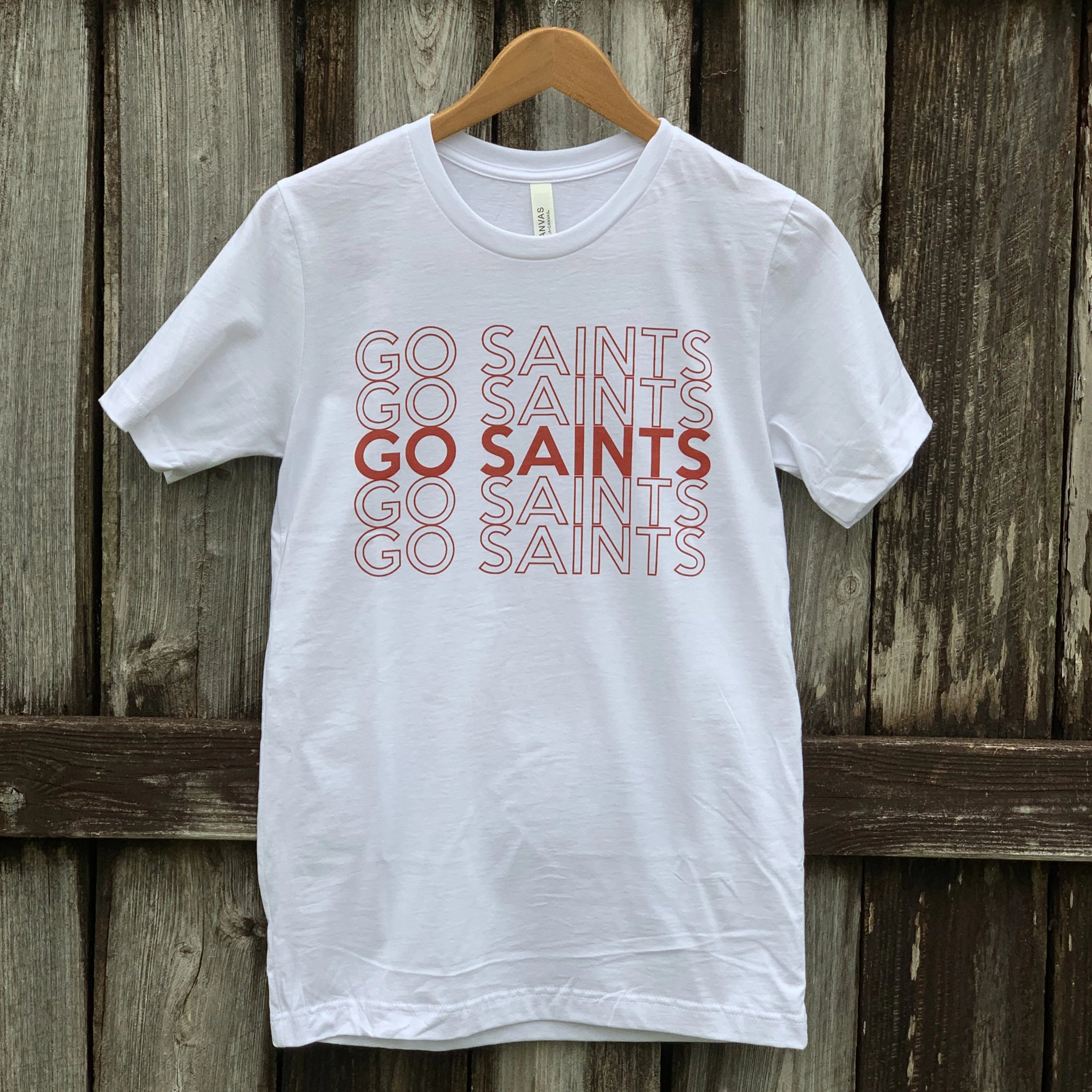 white t-shirt with go saints printed in red 5 times in a row