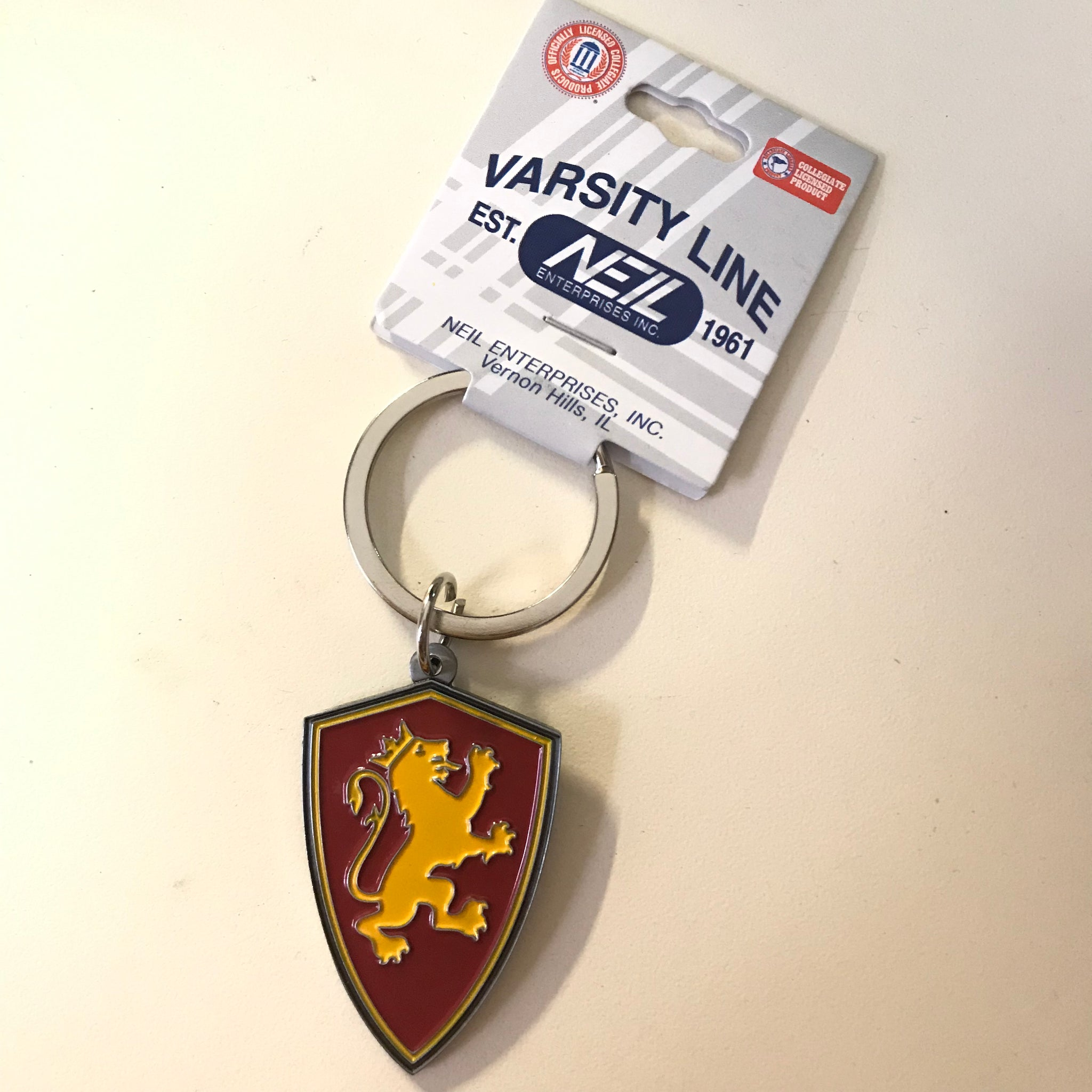red and yellow metal shield keychain