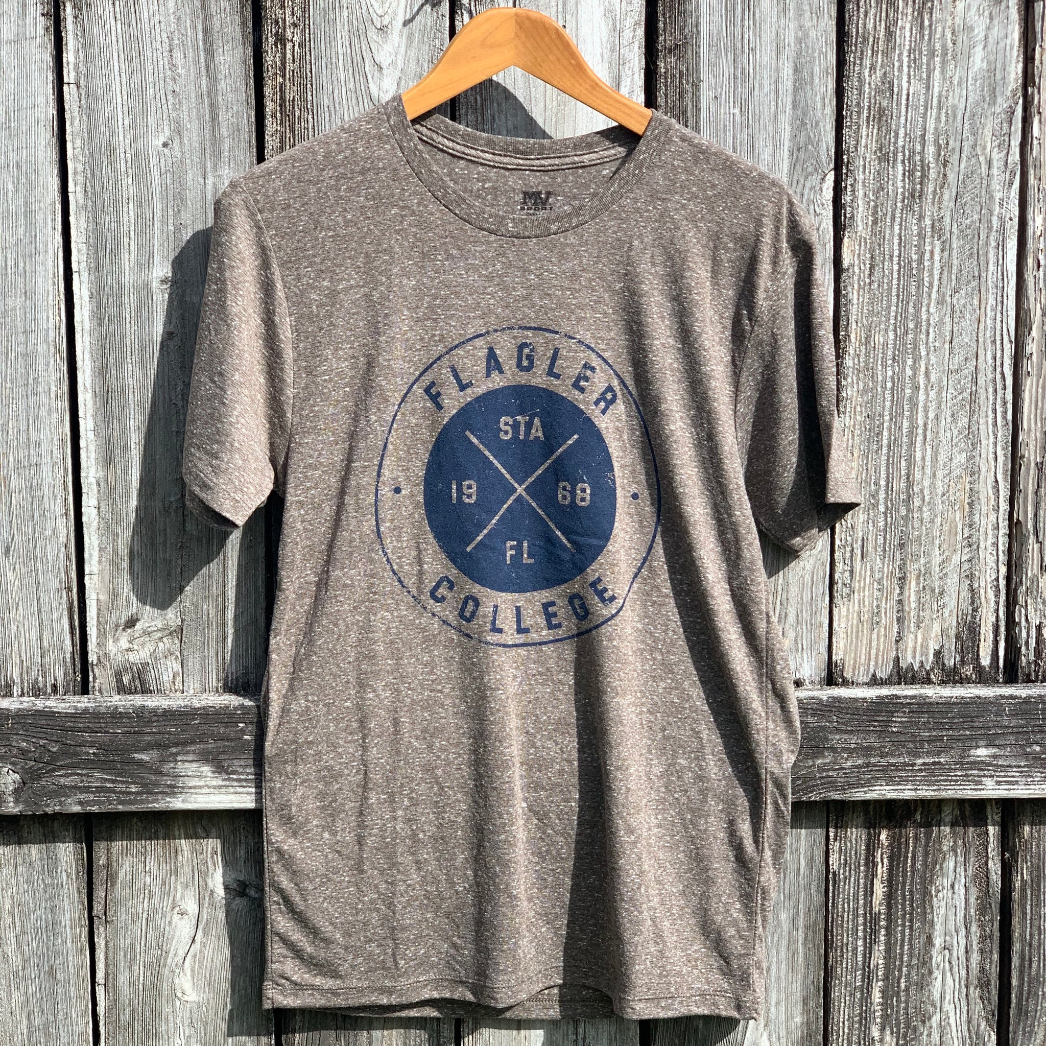 Grey t-shirt with Flagler college, STA, FL and 1968 printed in blue in a circular design