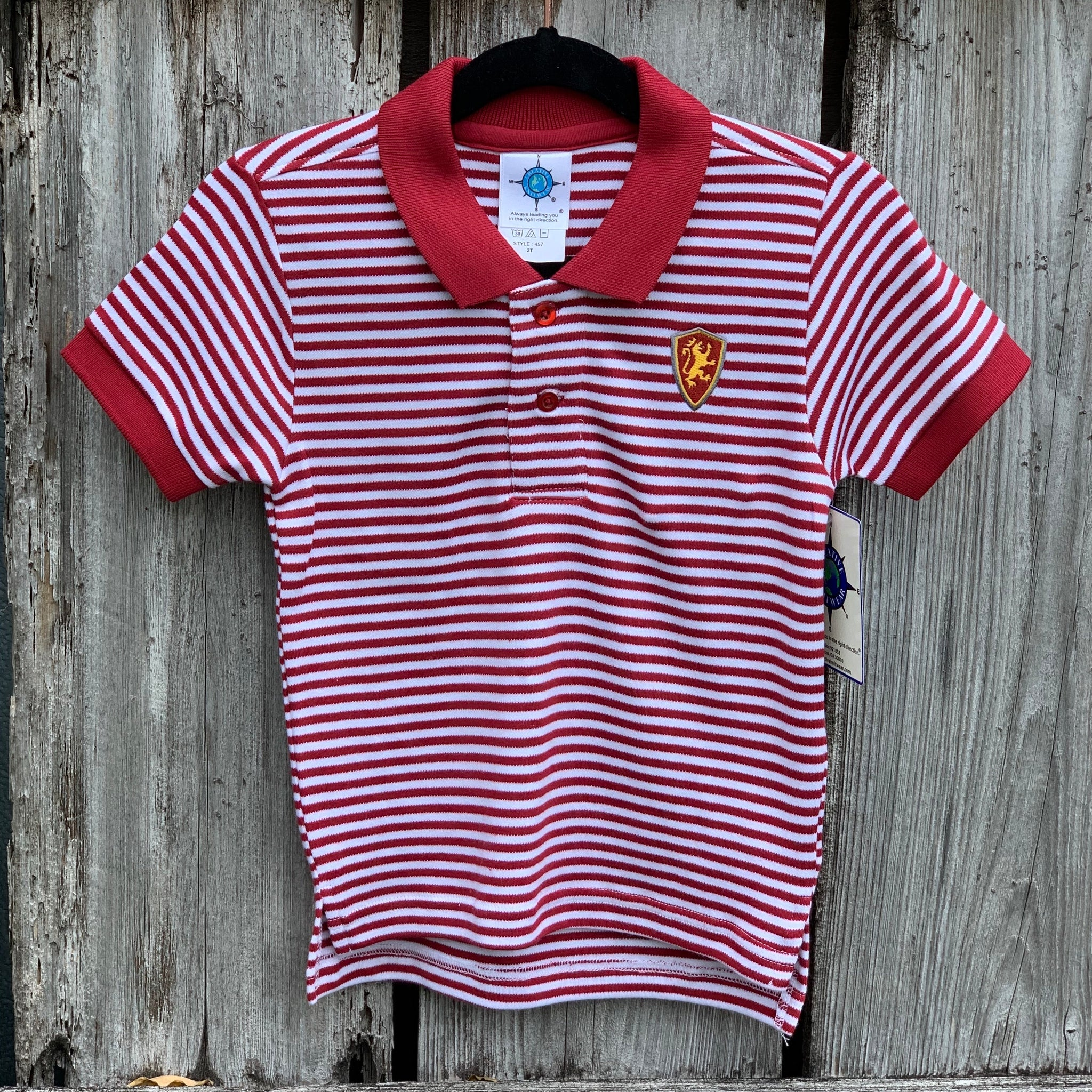 child's red and white stripped polo with red and yellow lion shield patch on left chest