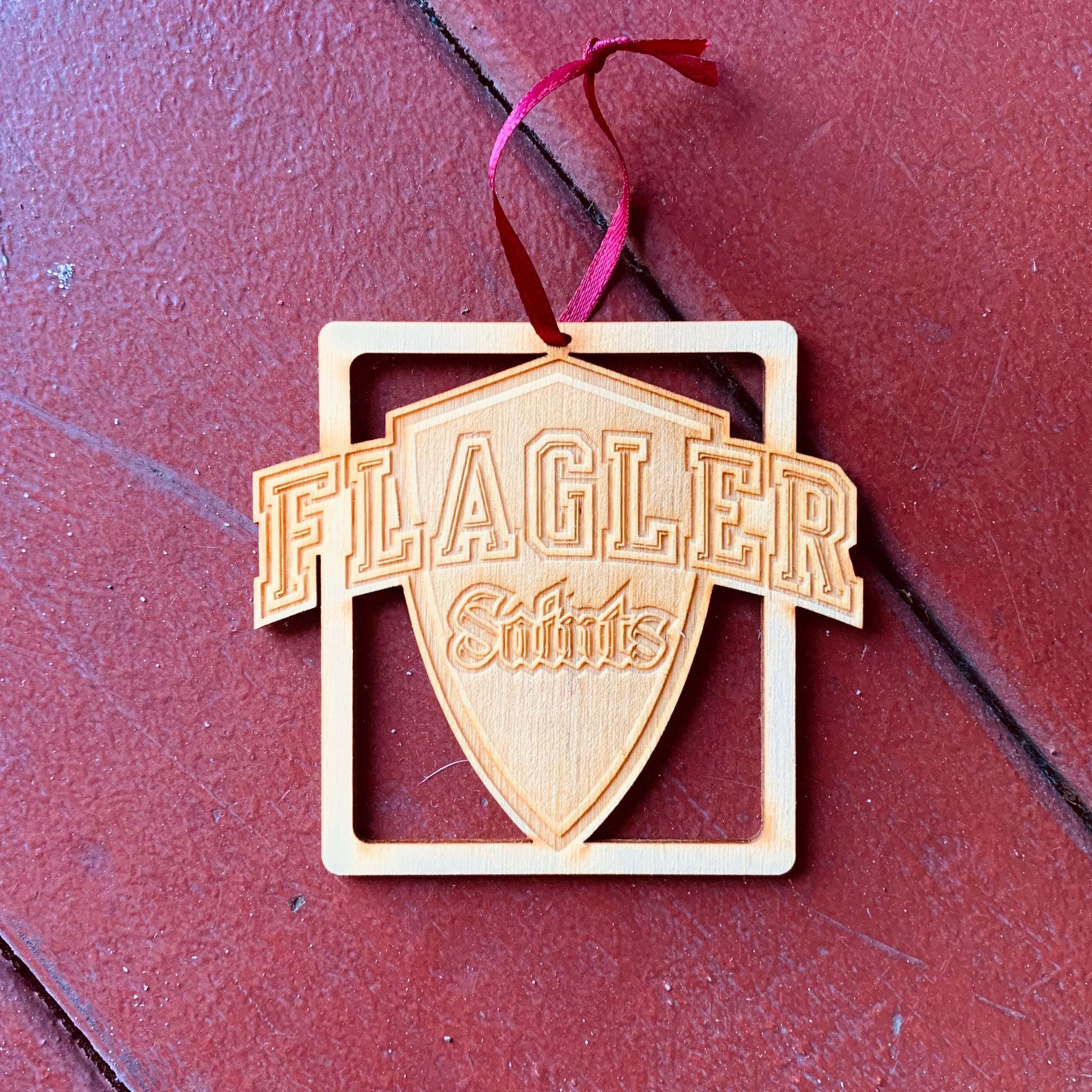 Flagler saints shield wooden ornament