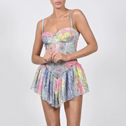 High-waisted mini dress with colorful print suspenders
